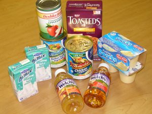 Photo of food included in Meals on Wheels Blizzard Bags. Includes juice, apple sauce, vanilla pudding, and crackers