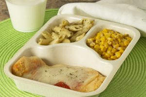 A plate of food with corn and pasta that is offered in a meals on wheel delivery.